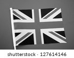 Union Jack Flag of UK on Red Card Background in Black and White - stock photo