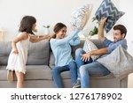 happy parents with kid daughter ... | Shutterstock . vector #1276178902