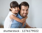 happy dad carrying little cute... | Shutterstock . vector #1276179022