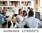 excited diverse business team... | Shutterstock . vector #1276205272