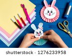child makes bunnies out of... | Shutterstock . vector #1276233958