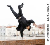 stylish young man dancer in... | Shutterstock . vector #1276240075