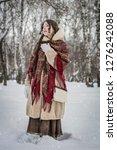 girl smile in cold winter day...   Shutterstock . vector #1276242088