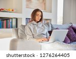 shot of a casual young woman... | Shutterstock . vector #1276264405