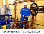 engineer maintenance works on... | Shutterstock . vector #1276268125