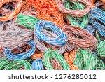 random weaving of colored wire. ...   Shutterstock . vector #1276285012