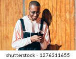 young black man wearing casual... | Shutterstock . vector #1276311655