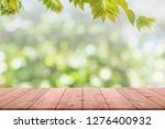 empty wood table top and... | Shutterstock . vector #1276400932