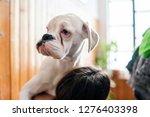close up on girl holding white... | Shutterstock . vector #1276403398