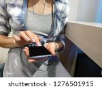 photo female hands holding a...   Shutterstock . vector #1276501915