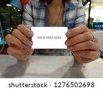 photo female hands holding...   Shutterstock . vector #1276502698