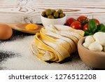 raw yellow italian pasta... | Shutterstock . vector #1276512208