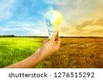 human hands holding earth... | Shutterstock . vector #1276515292
