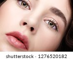 Stock photo closeup beauty macro face portrait of young woman brunette girl with day nude female makeup 1276520182