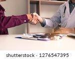 doctor shaking hands with older ...   Shutterstock . vector #1276547395