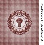 light bulb icon inside red...   Shutterstock .eps vector #1276553962