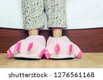 female legs in warm pajama and... | Shutterstock . vector #1276561168