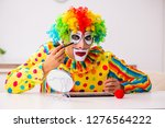 male clown preparing for... | Shutterstock . vector #1276564222