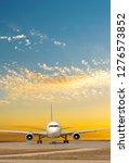 passenger jet plane on the... | Shutterstock . vector #1276573852