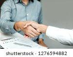 confident partnerships people...   Shutterstock . vector #1276594882