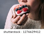 woman bites sandwich with fresh ... | Shutterstock . vector #1276629412