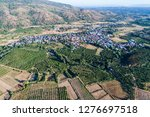aerial view of village... | Shutterstock . vector #1276697518
