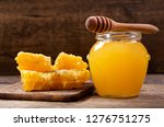 jar of honey and honeycombs on... | Shutterstock . vector #1276751275