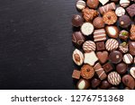 chocolate candies on dark table ... | Shutterstock . vector #1276751368