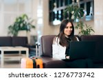 woman with laptop and luggage... | Shutterstock . vector #1276773742