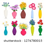 Set Of Colored Vases With...