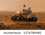 mars rover exploring surface of ... | Shutterstock . vector #1276784482