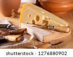 a piece of fresh tasty cheese... | Shutterstock . vector #1276880902
