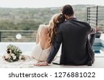 back view of a couple sitting... | Shutterstock . vector #1276881022