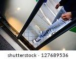 Motion blurred man enters subway train - stock photo