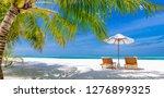 tropical beach resort. umbrella ...   Shutterstock . vector #1276899325