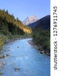 fresh mountain river at sundown ...   Shutterstock . vector #1276911745