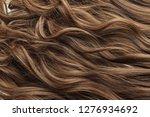 single piece clip in brown wavy ...   Shutterstock . vector #1276934692