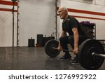athletic unshaven grandfather... | Shutterstock . vector #1276992922
