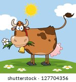 brown dairy cow with flower in...