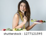 girl on dieting for weight loss ...   Shutterstock . vector #1277121595