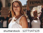woman activist with word strong ... | Shutterstock . vector #1277147125