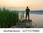 angler catching the fish from... | Shutterstock . vector #1277175082