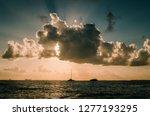 sunbeams at sunset hour in isla ... | Shutterstock . vector #1277193295