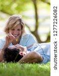 smiling couple relaxing lying... | Shutterstock . vector #1277226082