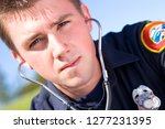 portrait of male paramedic with ... | Shutterstock . vector #1277231395
