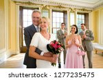 mature couple with guests... | Shutterstock . vector #1277235475