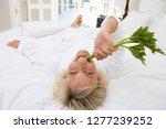 woman wearing white bathrobe in ... | Shutterstock . vector #1277239252