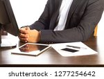 lawyer sits for desk in office | Shutterstock . vector #1277254642