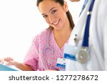 doctor discussing medical... | Shutterstock . vector #1277278672