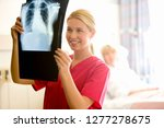 female nurse with x ray of... | Shutterstock . vector #1277278675